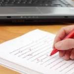 mão caneta caderno